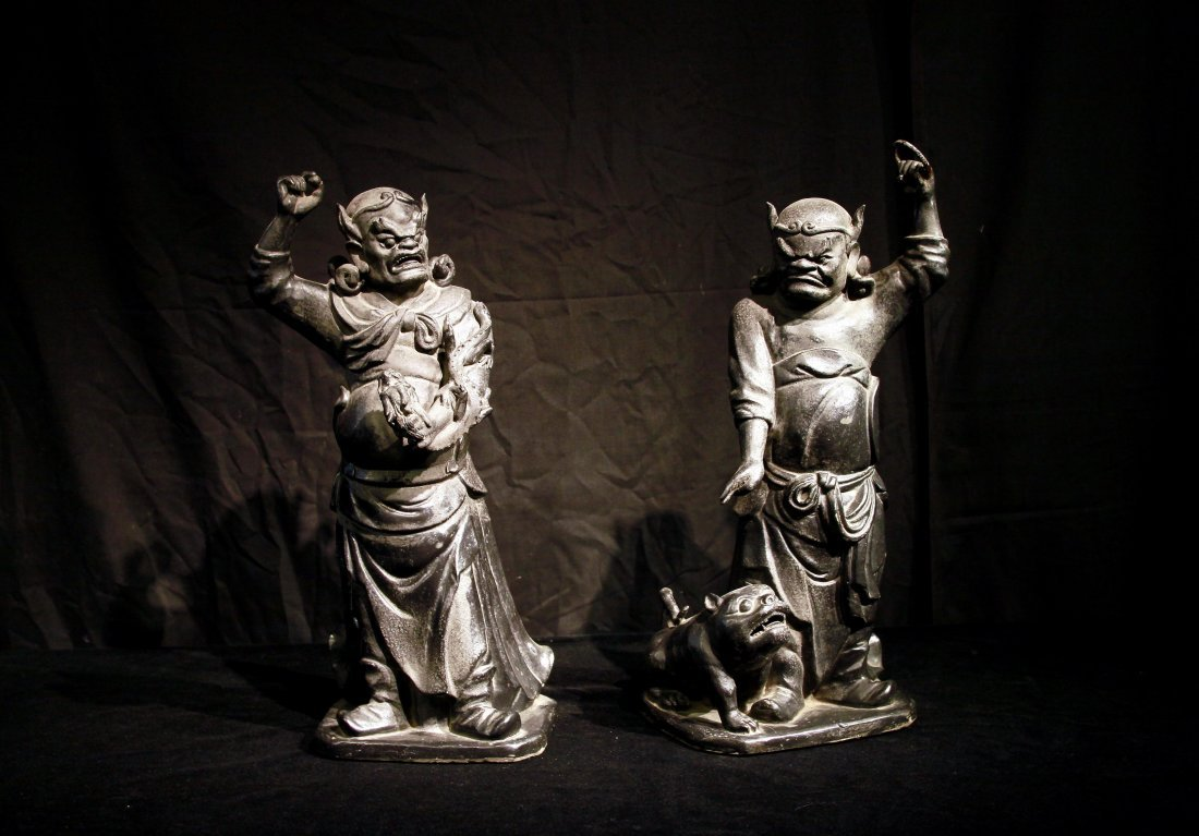 Important Pair of Qing Dynasty Black Porcelain Luohans