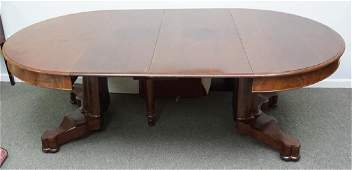 ROUND MAHOGANY DINING TABLE WITH TWO LEAVES