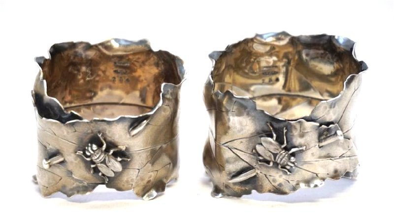 PAIR OF JAPANESQUE STERLING NAPKIN RINGS