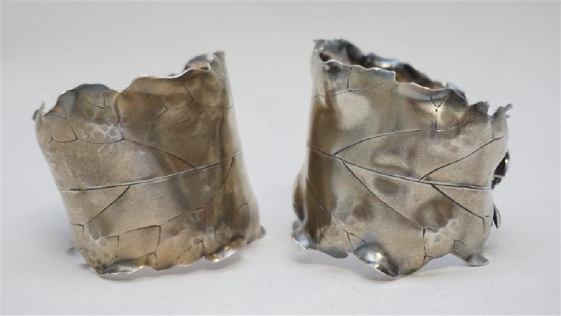 PAIR OF JAPANESQUE STERLING NAPKIN RINGS - 3