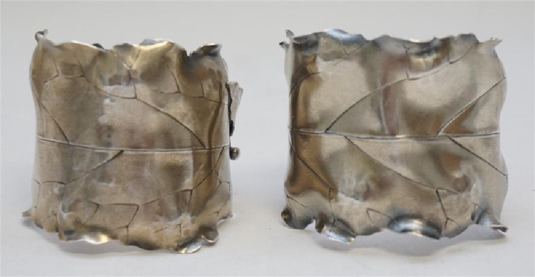 PAIR OF JAPANESQUE STERLING NAPKIN RINGS - 4