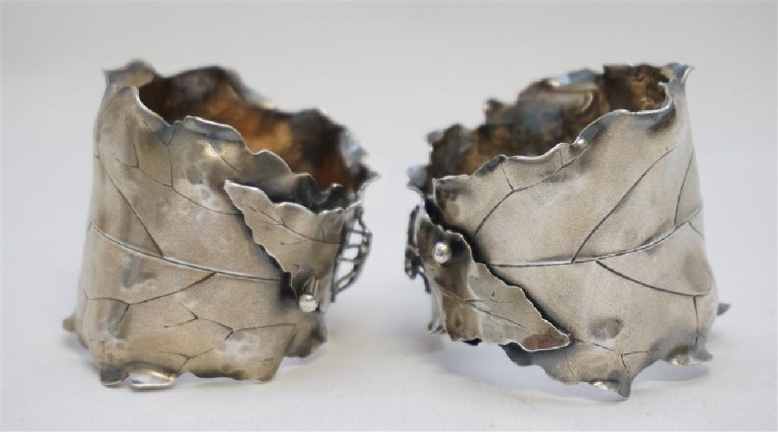 PAIR OF JAPANESQUE STERLING NAPKIN RINGS - 5