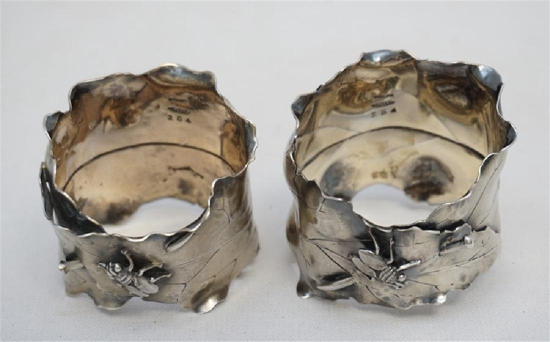 PAIR OF JAPANESQUE STERLING NAPKIN RINGS - 7