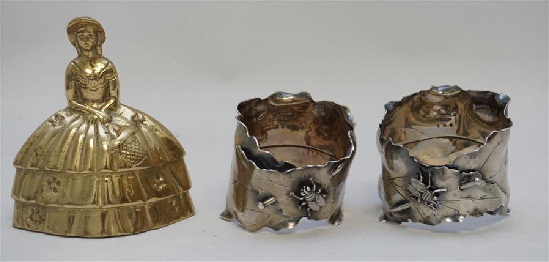 PAIR OF JAPANESQUE STERLING NAPKIN RINGS - 9