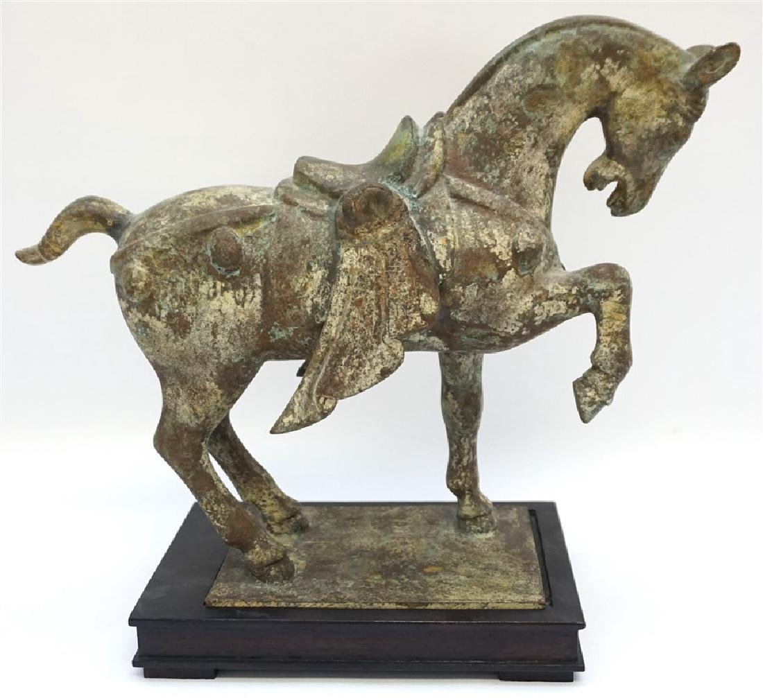 CHINESE TANG DYNASTY PATINATED BRONZE HORSE