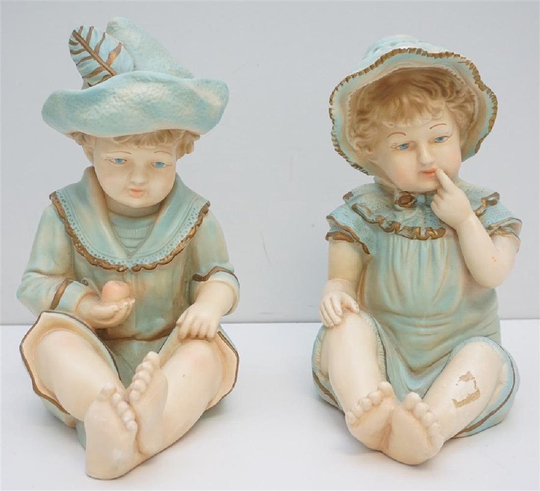 PAIR VINTAGE LARGE CERAMIC PIANO BABIES