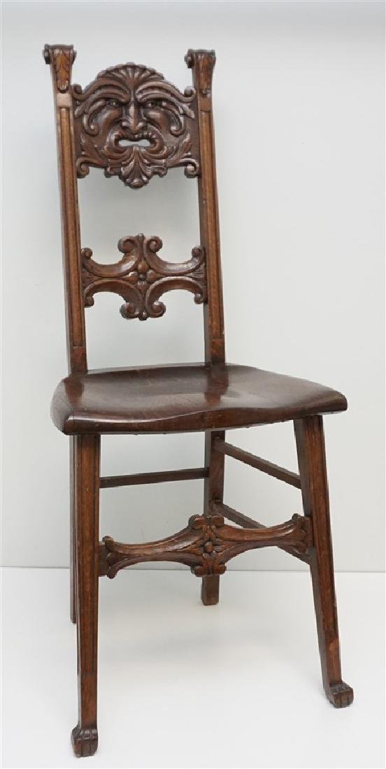 AMERICAN CARVED OAK NORTH WIND CHAIR c 1900
