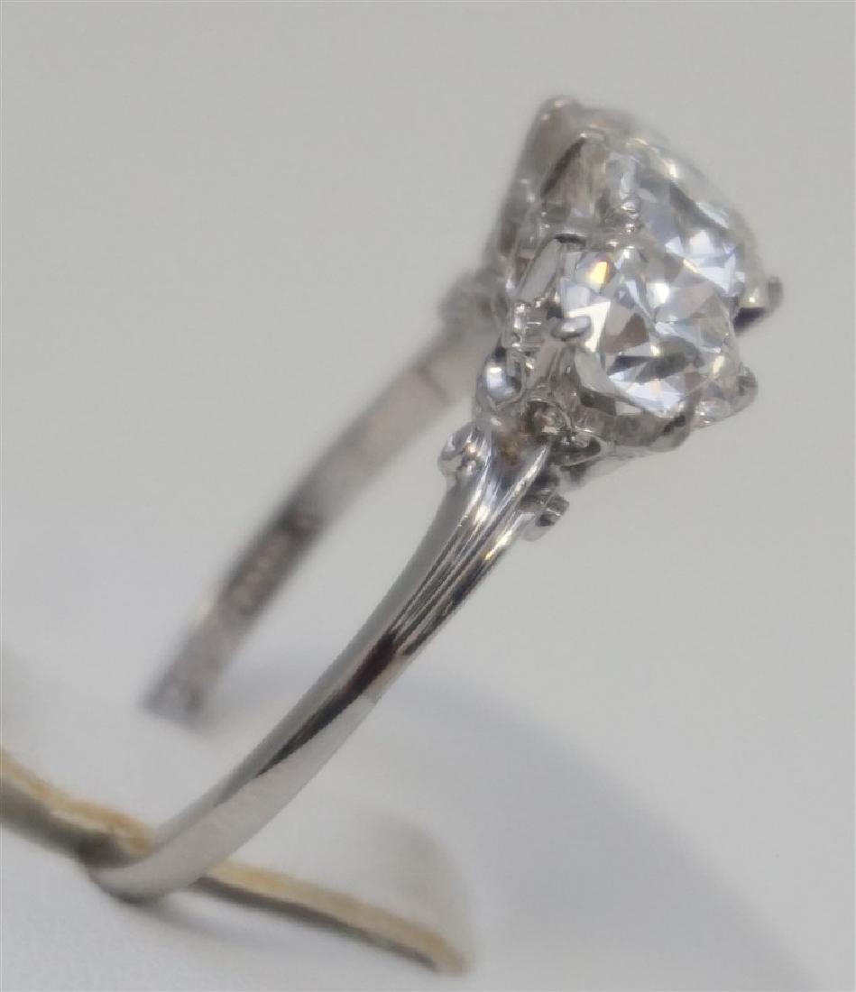 PLATINUM THREE DIAMOND RING (4.00CTS/TW) - 6