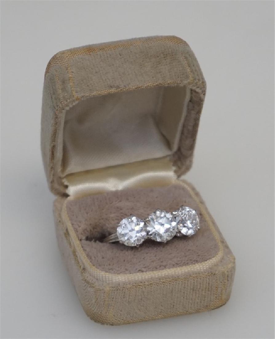 PLATINUM THREE DIAMOND RING (4.00CTS/TW) - 9