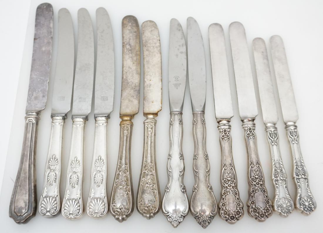 12 VARIOUS STERLING HANDLE DINNER KNIVES