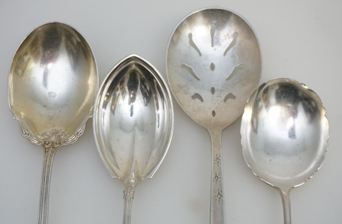 4 STERLING SILVER SERVING SPOONS - 4