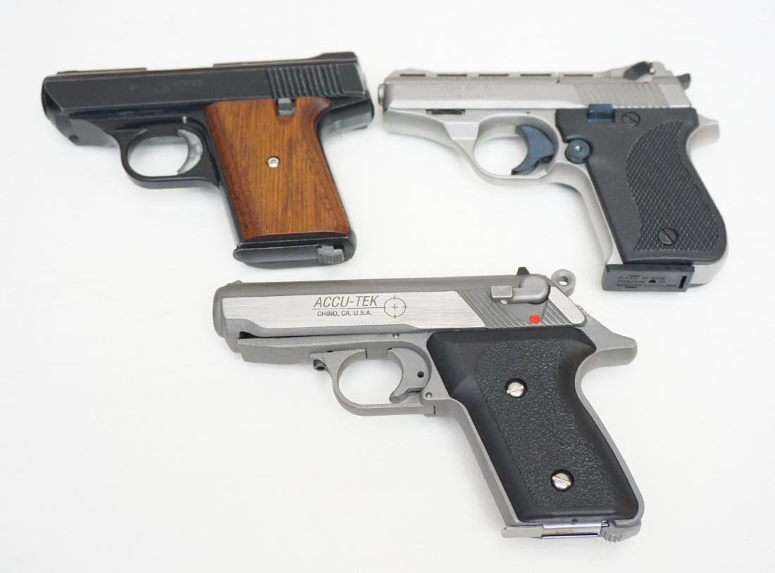 3 PISTOLS IN ORIG BOXES + 4 HOLSTERS - 8