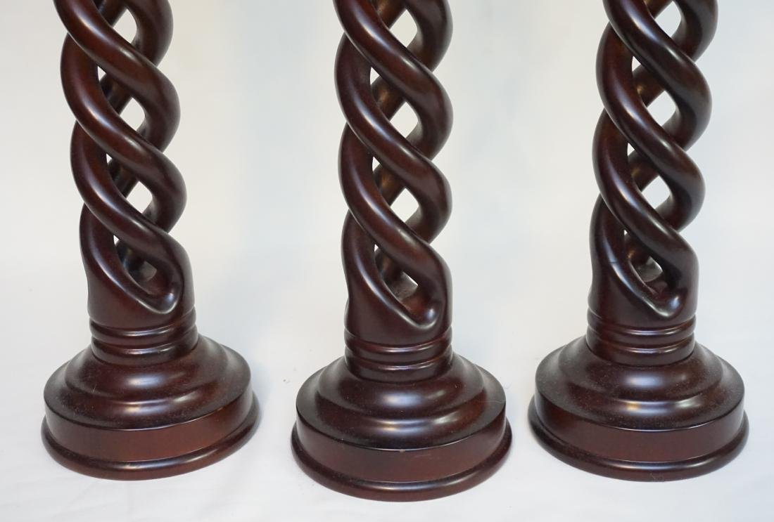 3 MAHOGANY TWISTED CANDLE STANDS - 3