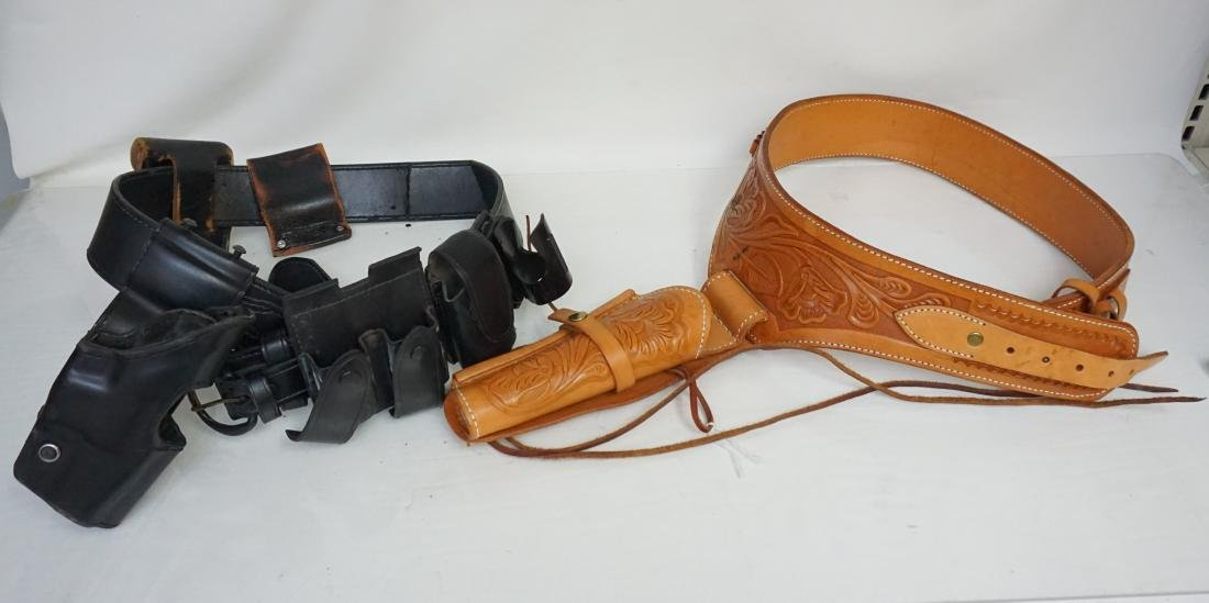2 LEATHER GUN HOLSTERS