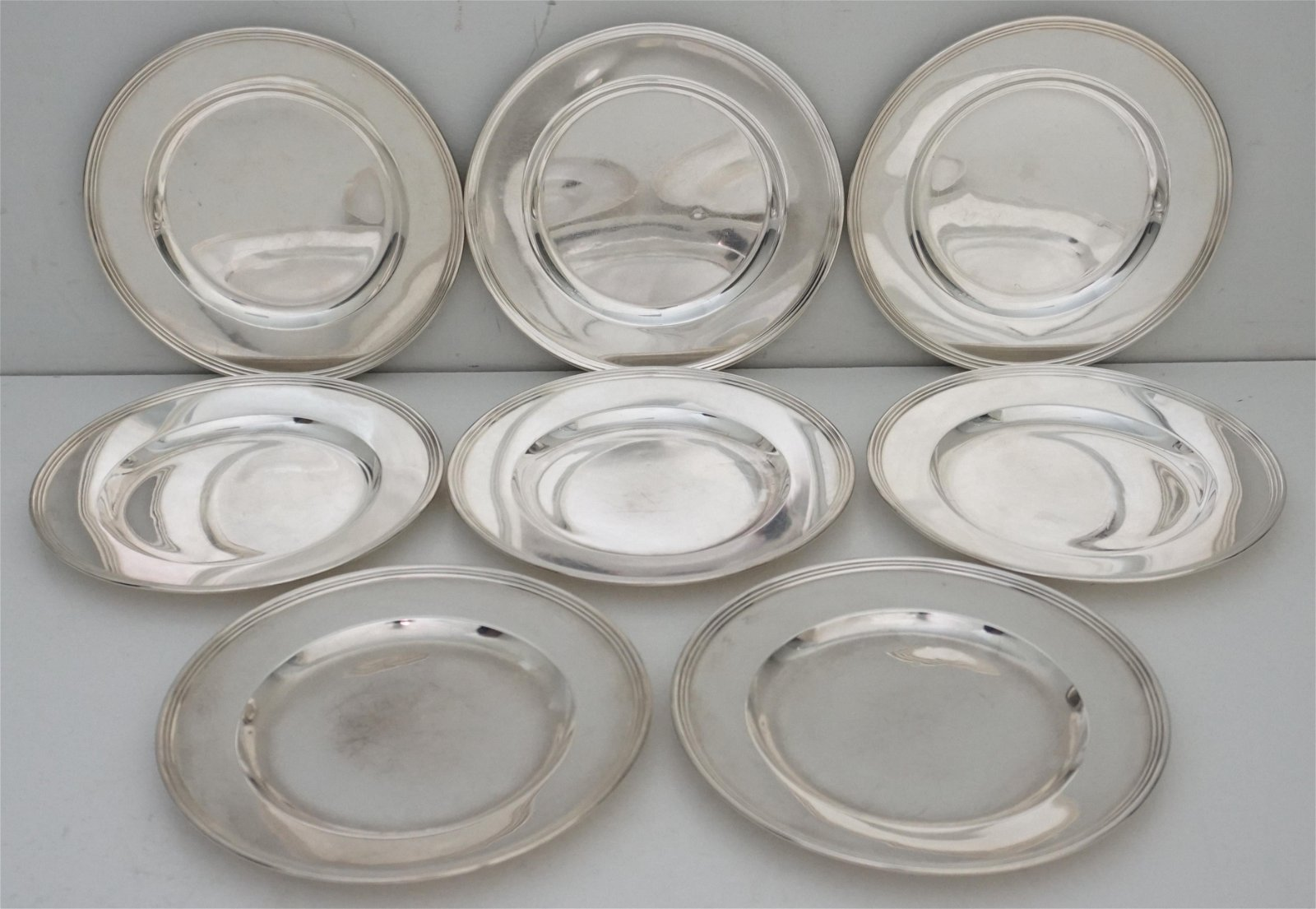 8 AMERICAN STERLING BREAD PLATES