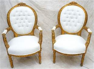 PAIR FRENCH CARVED AND GILDED ARM CHAIRS