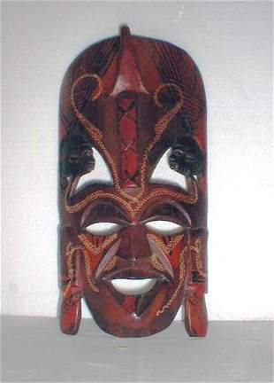 Carved and painted wooden mask