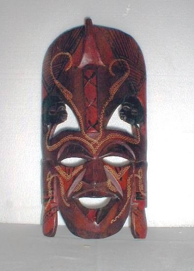 14: Carved and painted wooden mask