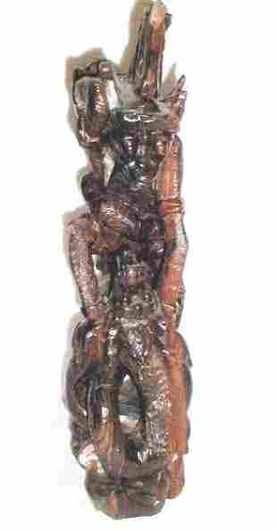 Monkey Demon astride serpent in elaborately carved