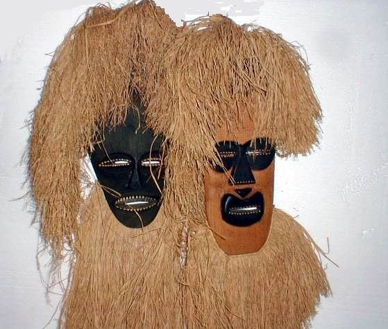 23: Pair of African Masks with grass head pieces