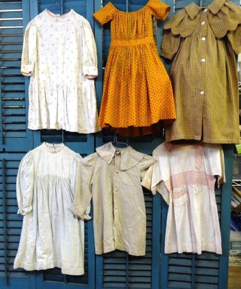 Six  early children's dresses