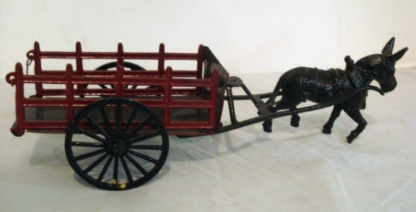 8: Cast Iron Stake Horse Drawn Wagon