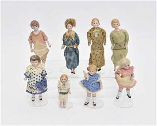 Eight Vintage Bisque Dollhouse Dolls