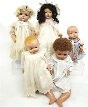 Four Composition Dolls