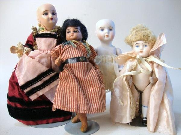 20: Grouping of Four Small Bisque Dolls