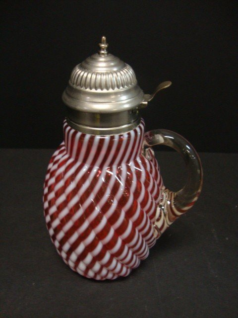 821: Covered Cranberry Opalescent Syrup Jug