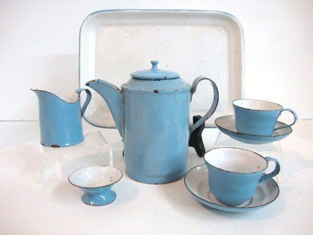 84: Child's Blue and White Granite Tea Set
