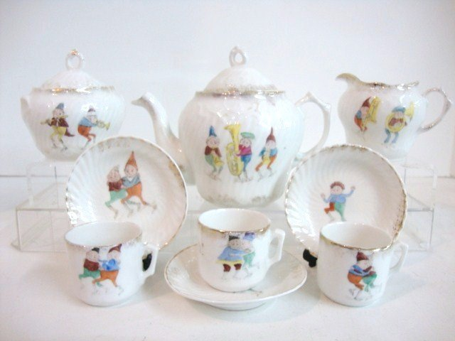 85: Child's Palmer Cox Tea Set