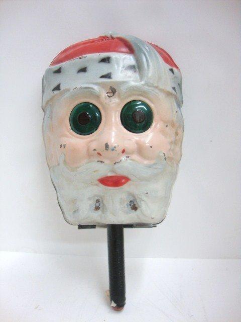 18: Painted Tin Santa Face Eye Sparkler