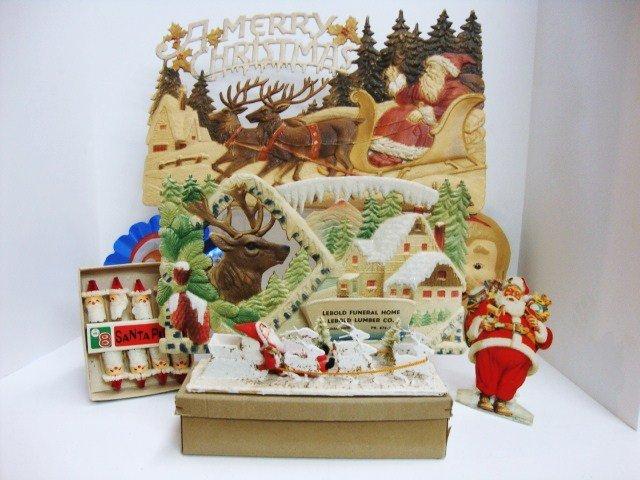 23: Pressed Cardboard Santas, etc.