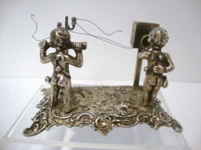 21: Silver Figurines