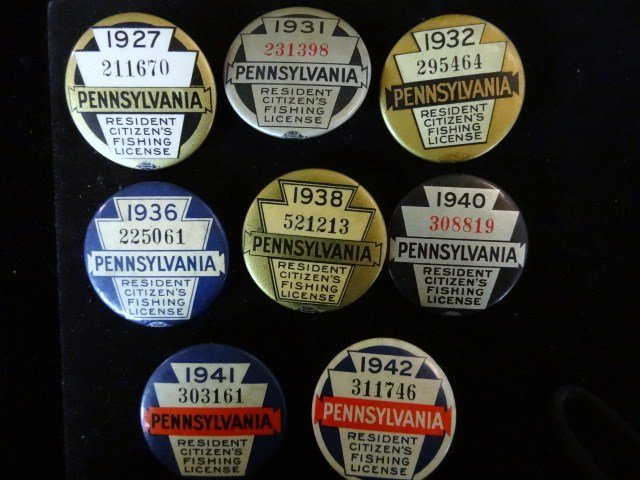 Eight PA Fishing License Buttons 1927-1942