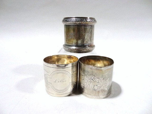 Three Coin Silver Napkin Rings
