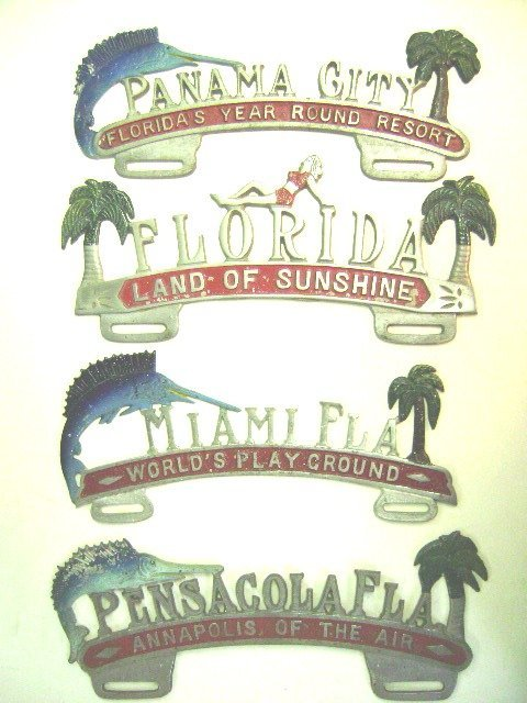 Four Florida License Plate Toppers