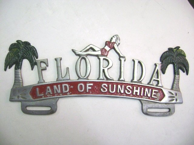 Four Florida License Plate Toppers - 4