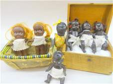 Grouping of Seven Small Black Dolls