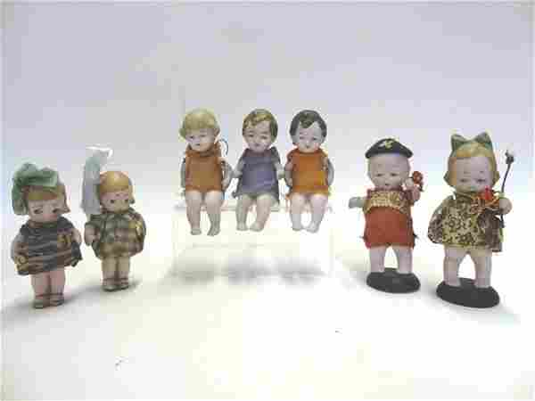 Seven Small Bisque Dolls