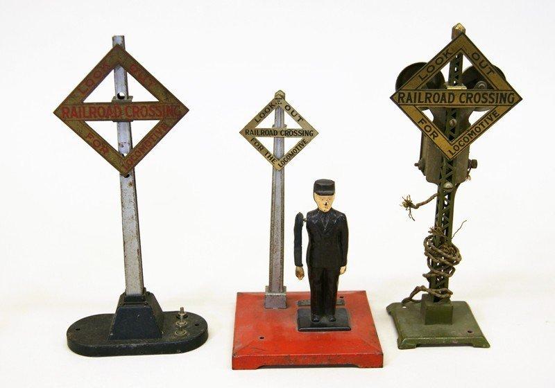 Thirteen Lionel Accessory Pieces, Crossings, Beacon, - 2