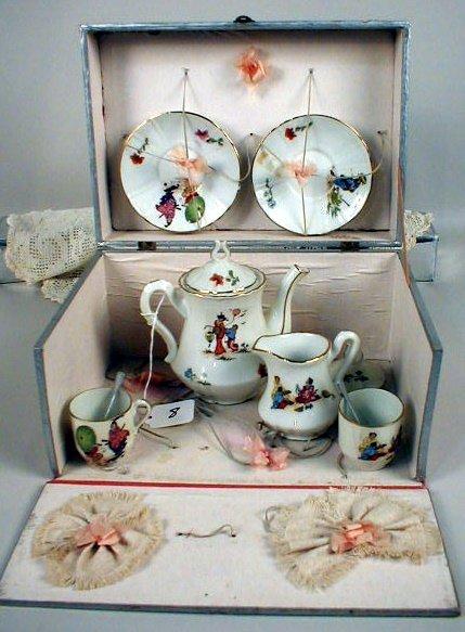 8: Child's Limoges Tea Set in Box.  Oriental Figures