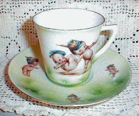 16: Kewpie cup and saucer