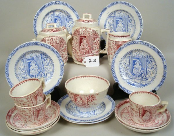 23: Staffordshire Girl with Pets Tea Set. Red and blue