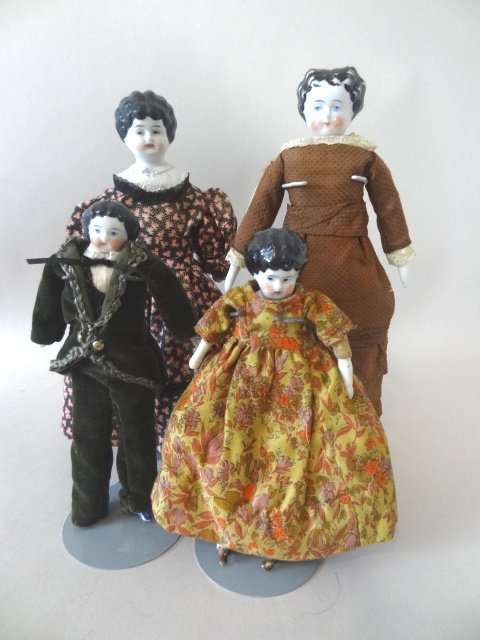Grouping of Four China Head Dolls