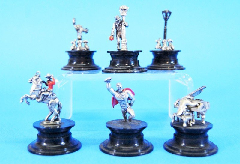 Six Small Silver Miniatures