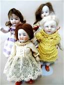 Four Small Stone Bisque Dolls