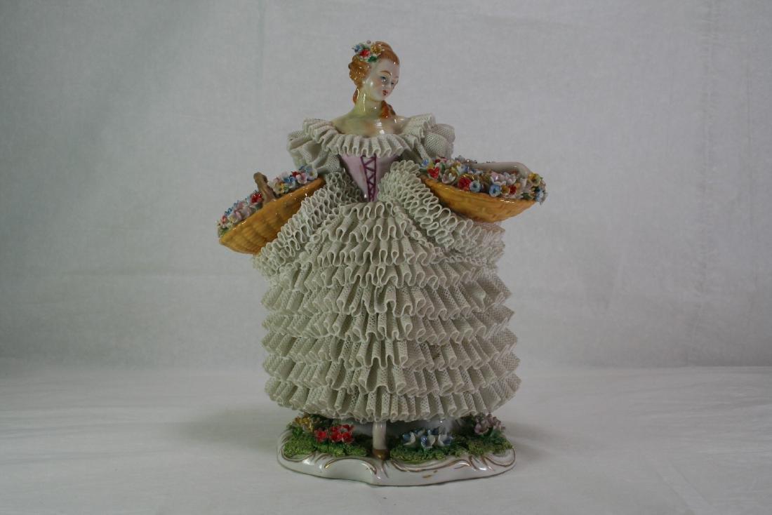 Porcelain Figure of a Flower Lady