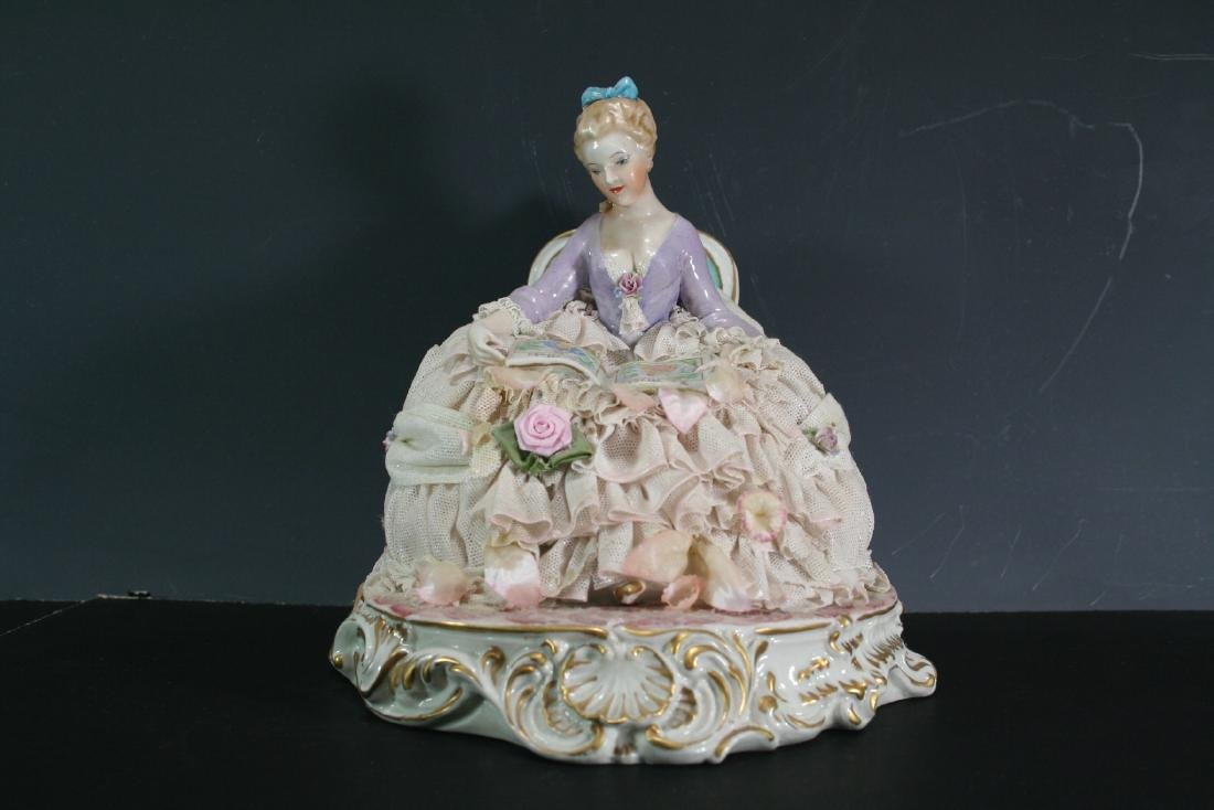 Porcelain Figure of a Reading Lady